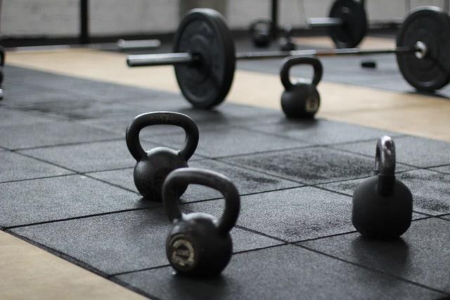 Dumbells on a gym floor.
