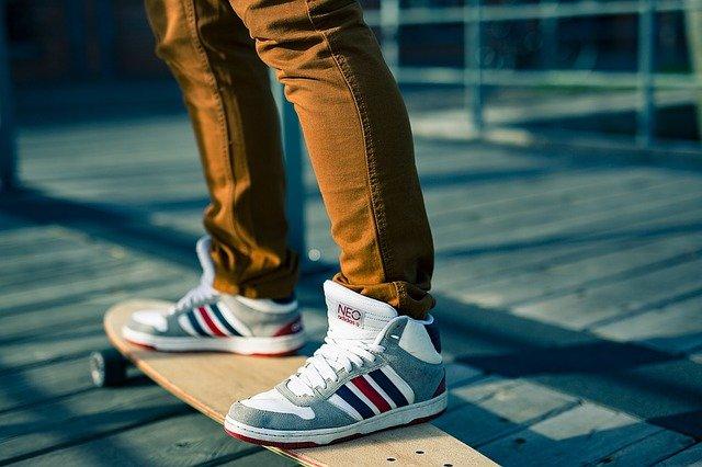 A skateboarder standing on a skateboard